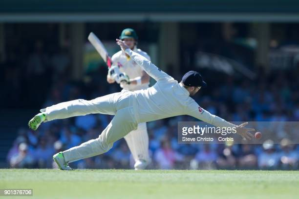 Dawid Malan of England dives to stop runs from Australia's Steve Smith during day two of the Fifth Test match in the 2017/18 Ashes Series between...