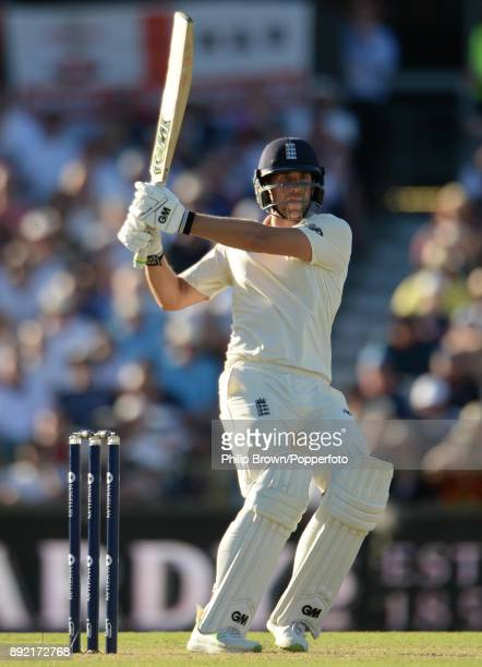 Dawid Malan of England hits a four to reach his century during the first day of the third Ashes cricket test match between Australia and England at...