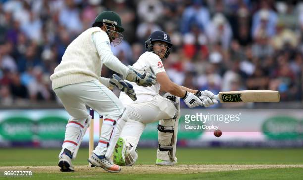Dawid Malan of England hits past Pakistan wicketkeeper Sarfraz Ahmed during day two of the 2nd NatWest Test match between England and Pakistan at...