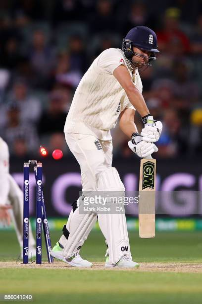 Dawid Malan of England is bowled by Pat Cummins of Australia during day four of the Second Test match during the 2017/18 Ashes Series between...