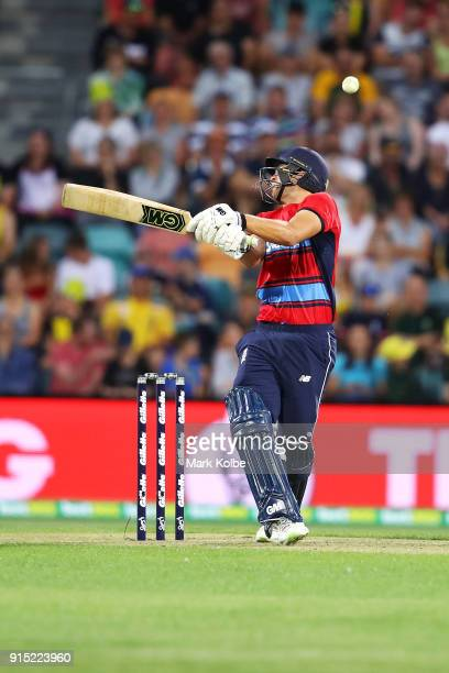 Dawid Malan of England is struck by a short ball Andrew Tye of Australia during the Twenty20 International match between Australia and England at...