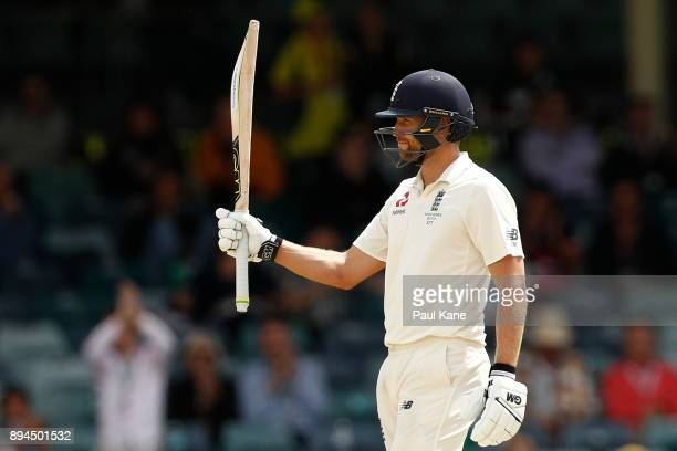 Dawid Malan of England raises his bat to the players rooms after reaching his half century during day five of the Third Test match during the 2017/18...