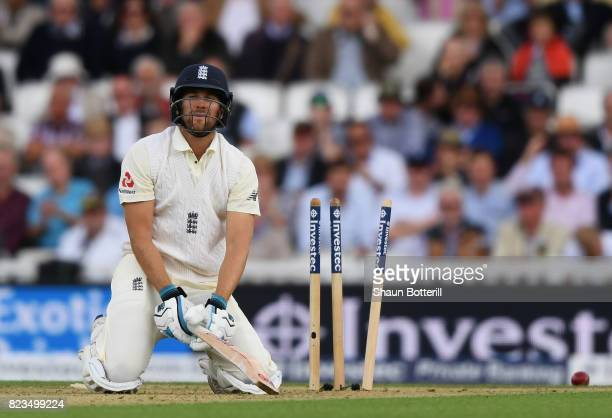 Dawid Malan of England reacts to being bowled by Kagiso Rabada of South Africa during the 3rd Investec Test match between England and South Africa at...