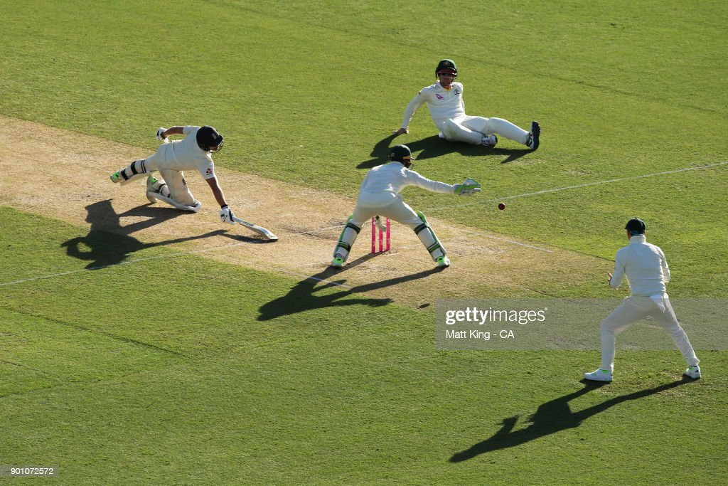 Dawid Malan of England slides in to avoid a runout chance by Cameron Bancroft of Australia during day one of the Fifth Test match in the 2017/18 Ashes Series between Australia and England at Sydney Cricket Ground on January 4, 2018 in Sydney, Australia.