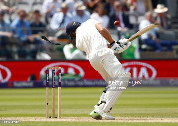Dawid Malan of England takes a hit to the helmut as a piece comes off during day three of the 1st Test match between England and Pakistan at Lord's...