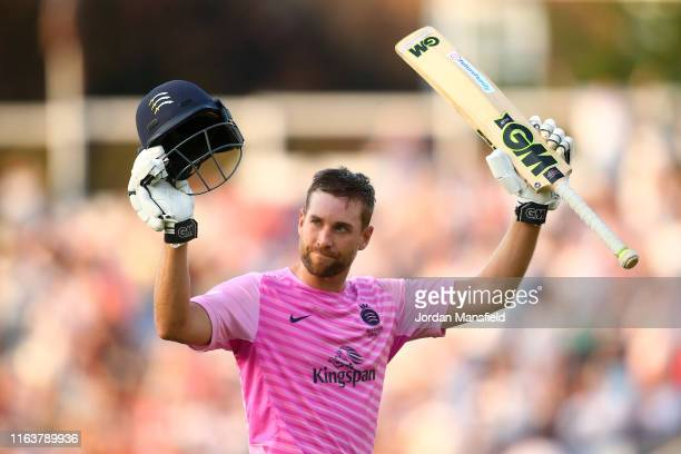 Dawid Malan of Middlesex acknowledges the crowd as he makes his way off the field after being dismissed by Tom Curran of Surrey during the Vitality...