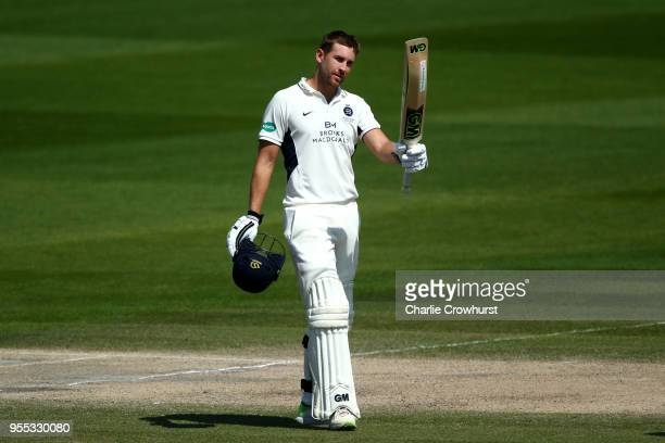 Dawid Malan of Middlesex celebrates his century during day three of the Specsavers County Championship Division Two match between Sussex and...