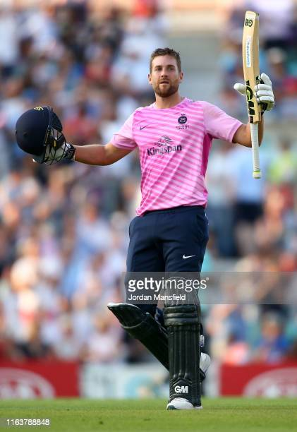 Dawid Malan of Middlesex celebrates his century during the Vitality Blast match between Surrey and Middlesex at The Kia Oval on July 23 2019 in...