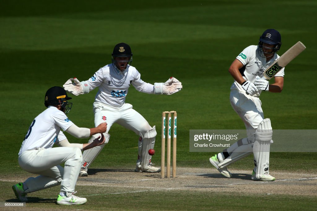 Dawid Malan of Middlesex hits out while Ben Brown and Phillip Salt of Sussex look on during day three of the Specsavers County Championship: Division Two match between Sussex and Middlesex at The 1st Central County Ground on May 6, 2018 in Hove, England.