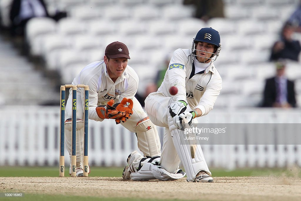 Dawid Malan of Middlesex in action as Gary Wilson of Surrey watches on during day four of the LV- County Championship Division Two match between Surrey and Middlesex at The Brit Oval on May 20, 2010 in London, England.