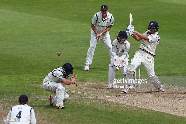 Dawid Malan of Middlesex pulls a delivery which hits Ian Westwood of Warwickshire fielding at silly mid on during day one of the Specsavers County...