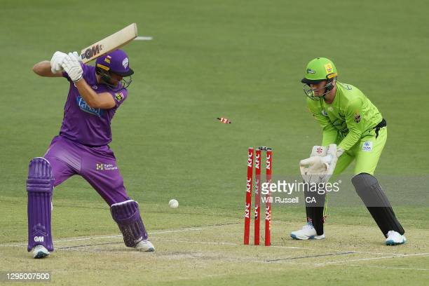 Dawid Malan of the Hurricanes is bowled by Chris Green of the Thunder during the Big Bash League match between the Hobart Hurricanes and the Sydney...