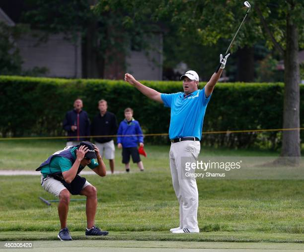 Dawie van der Walt of South Africa and his caddie react to just missing a birdie chip on the 10th playoff hole during the final round of the Webcom...