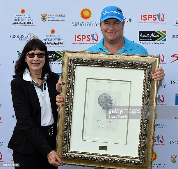 Dawie Van Der Walt of South Africa is presented with a picture of Nelson Mandela by Ina Cronje MEC finance Kwazulu Natal after the Nelson Mandela...