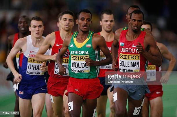 Dawit Wolde of Ethiopia and Ayanleh Souleiman of Djibouti compete in the Men's 1500 Metres Final during day four of the IAAF World Indoor...