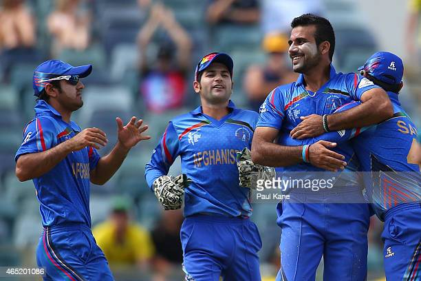 Dawlat Zadran of Afghanistan celebrates the wicket of Aaron Finch of Australia during the 2015 ICC Cricket World match between Australia and...