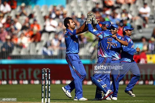 Dawlat Zadran of Afghanistan celebrates with team mates after dismissing Calum Macleod of Scotland during the 2015 ICC Cricket World Cup match...
