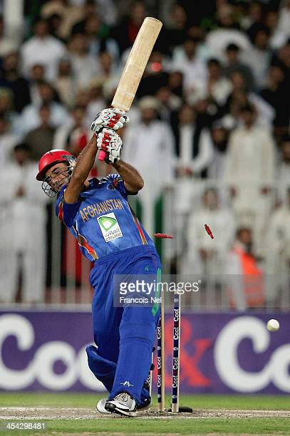 Dawlat Zadran of Afghanistan is bowled during the Twenty20 match between Afghanistan and Pakistan at the Sharjah Cricket Stadium on December 8 2013...