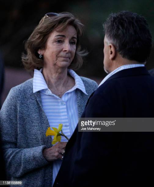 Dawn Anna left speaks to Frank DeAngelis former principal of Columbine High School at a candle light vigil for the victims of the 1999 Columbine High...