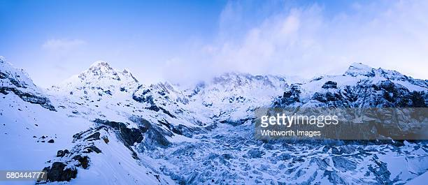 dawn at annapurna base camp - annapurna south stock photos and pictures