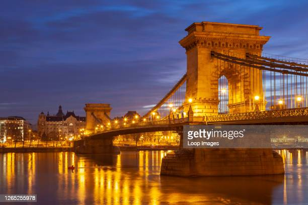 Dawn at Chain Bridge connecting Buda and Pest across river Danube.