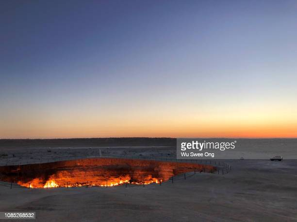 dawn at darvaza gas crater - sinkhole stock photos and pictures