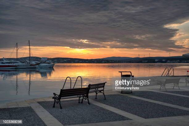 dawn at ilica bay on a cloudy summer day. - emreturanphoto stock pictures, royalty-free photos & images