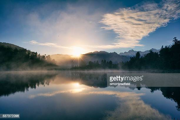 dawn at lake matheson - tranquility stock pictures, royalty-free photos & images