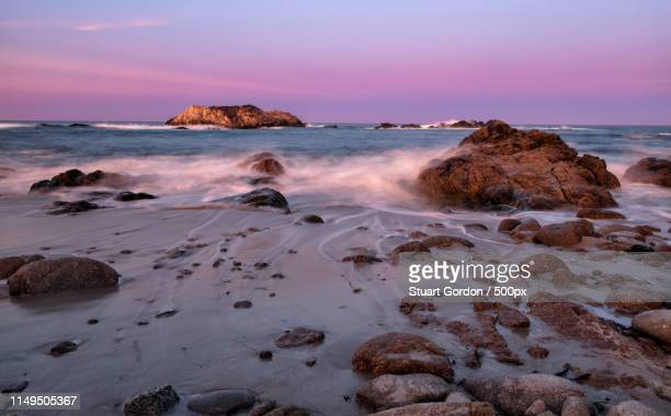 dawn at seal rock - pebble beach california stock pictures, royalty-free photos & images