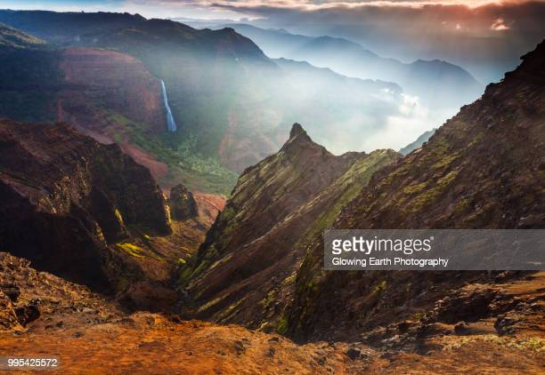 dawn at waimea canyon - waimea valley stock photos and pictures