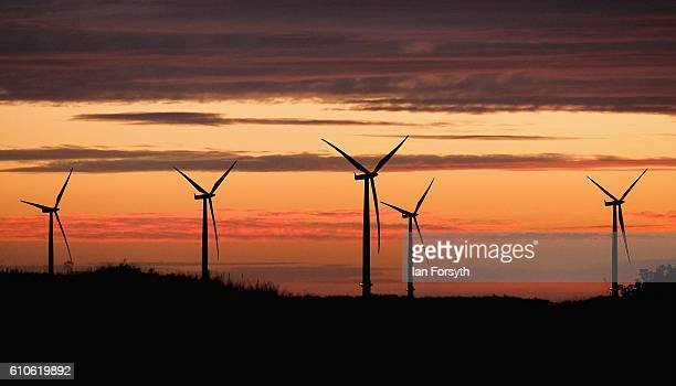 Dawn breaks behind the EDF Energy offshore windfarm on September 27 2016 in Redcar United Kingdom One year on since the SSI steel making plant at...