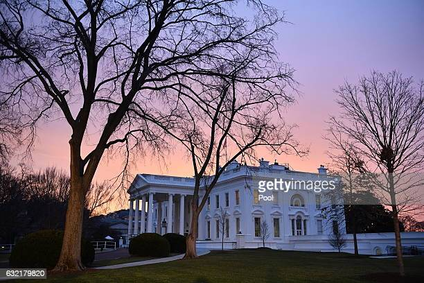 Dawn breaks behind the White House as the nation prepares for the inauguration of Presidentelect Donald Trump on January 20 2017 in Washington DC...