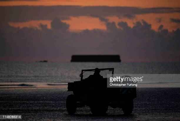 Dawn breaks over Gold Beach at Mulberry harbour on the morning of the 75th anniversary of the DDay landings on June 6 2019 in Arromanches Les Bains...
