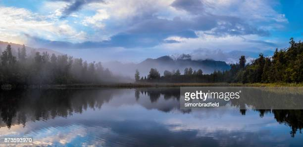 Dawn Breaks Over Lake Matheson In New Zealand