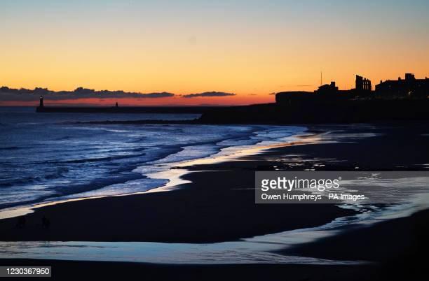Dawn breaks over Tynemouth beach.
