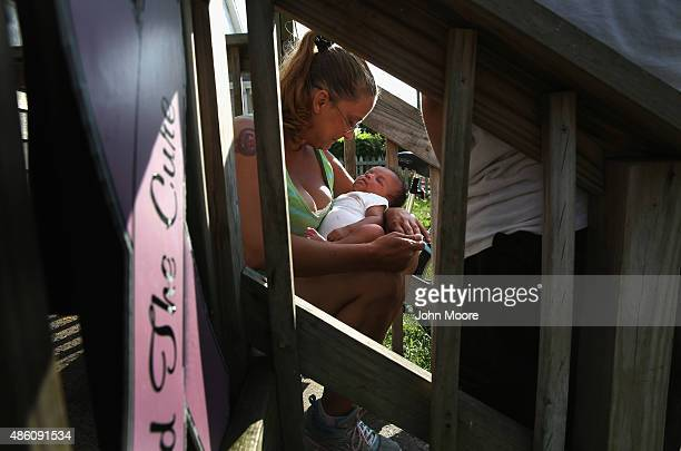 Dawn Bryant gives temporary shelter at her home to a friend's 5weekold homeless baby on August 26 2015 in Atlantic City New Jersey The baby's...