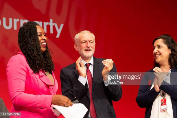 Dawn Butler Labour MP for Brent Central shadow women and equalities minister with Jeremy Corbyn leader of the Labour Party appear on stage at the...