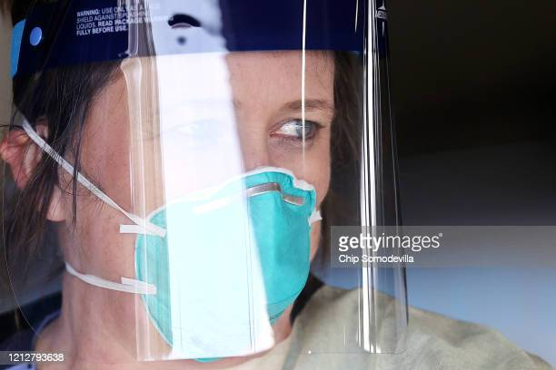 Dawn Canova, clinical manager for outpatient wound care at Carroll Hospital, prepares to take samples from people so to test them for the coronavirus...