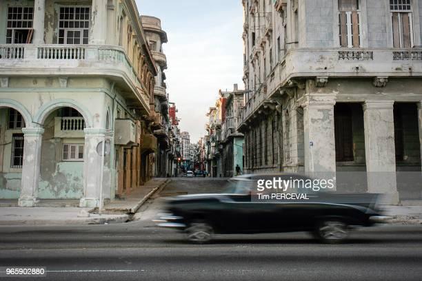 Dawn car passes by El Malecon Havana
