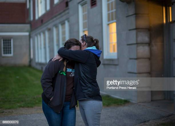 Dawn Cormier right hugs her niece Elizabeth Cormier during a vigil for Anie Graham a 13yearold girl who took her own life at Lewiston Middle School