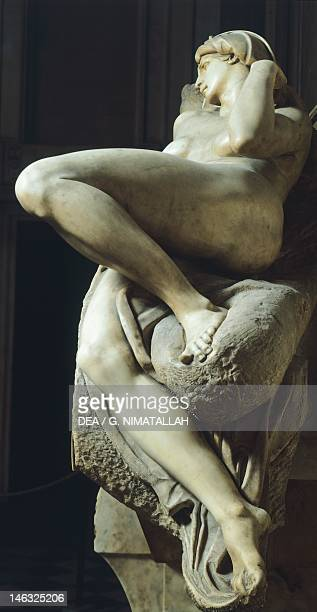 Dawn detail from the tomb of Lorenzo de' Medici 15241534 by Michelangelo marble sculpture Medici Chapel of the Church of San Lorenzo in Florence...