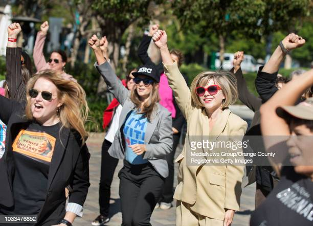 Dawn Dorland, center, and Elizabeth Holcombe, are part of the Hillary flash mob that broke out in a pantsuit dance in Culver City on Saturday...