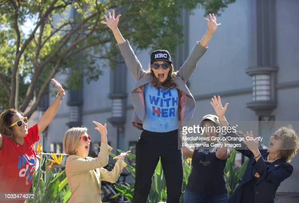 Dawn Dorland center jokes around with the Hillary Clinton flash mob after performing in a pantsuit flash mob dance in Culver City on Saturday...