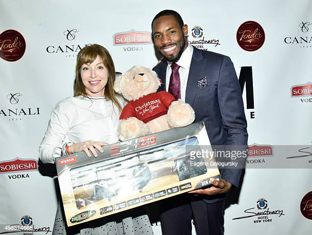 Dawn DuBois and Antonio Cromartie attend the GOTHAM Men's event with host Antonio Cromartie at Tender Restaurant in The Sanctuary Hotel at Tender at...