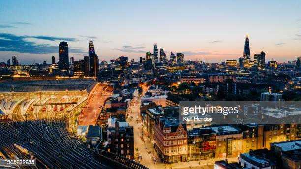 a dawn elevated view of the london skyline and waterloo station - stock photo - waterloo railway station london stock pictures, royalty-free photos & images
