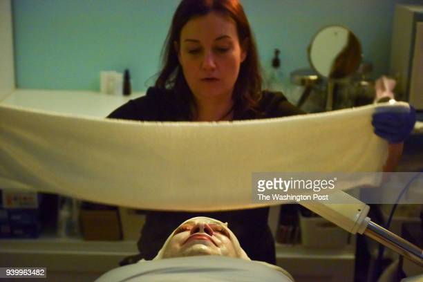 Dawn Franklin an aesthetician performs a facial on Maria Harris using CBDinfused cleansers masks and oils at Joy's Spa on Monday March 26 in...