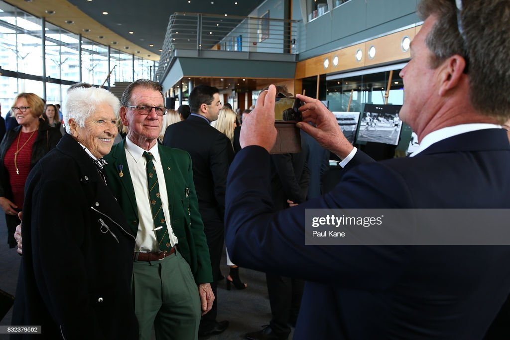Dawn Fraser poses for a photo with Henk Vogels during the funeral service for Betty Cuthbert at Mandurah Performing Arts Centre on August 16, 2017 in Mandurah, Australia. Betty Cuthbert was known as 'The Golden Girl' at the 1956 Melbourne Olympics, winning the 100m, 200m and 4x100m relay. After sustaining an injury at the Rome Olympics in 1960, Cuthbert came out of a short-lived retirement to win her fourth Olympic gold medal in the 400m at the 1964 Tokyo Olympic Games. Betty Cuthbert passed away on 6 August 2017, aged 79.