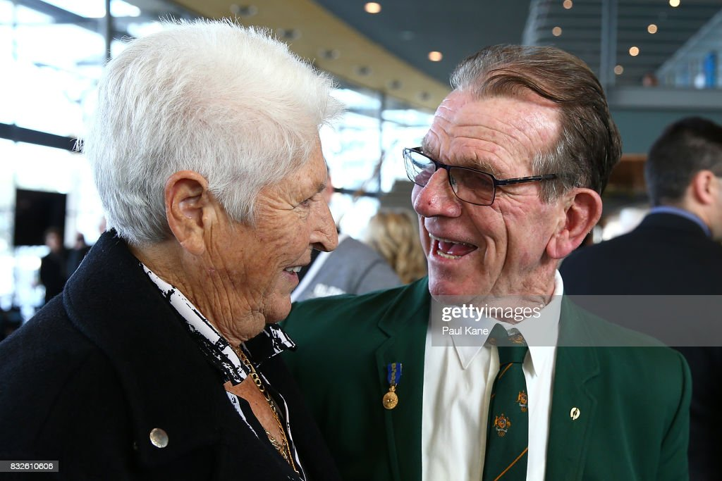 Dawn Fraser shares a moment with Henk Vogels during the funeral service for Betty Cuthbert at Mandurah Performing Arts Centre on August 16, 2017 in Mandurah, Australia. Betty Cuthbert was known as 'The Golden Girl' at the 1956 Melbourne Olympics, winning the 100m, 200m and 4x100m relay. After sustaining an injury at the Rome Olympics in 1960, Cuthbert came out of a short-lived retirement to win her fourth Olympic gold medal in the 400m at the 1964 Tokyo Olympic Games. Betty Cuthbert passed away on 6 August 2017, aged 79.