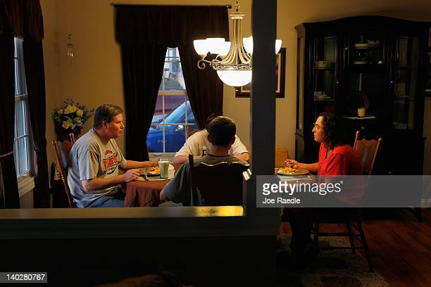 Dawn Gunkel her husband Fritz Gunkel and children eat dinner together in their home as they continue to struggle after Dawn lost her job of 15 years...