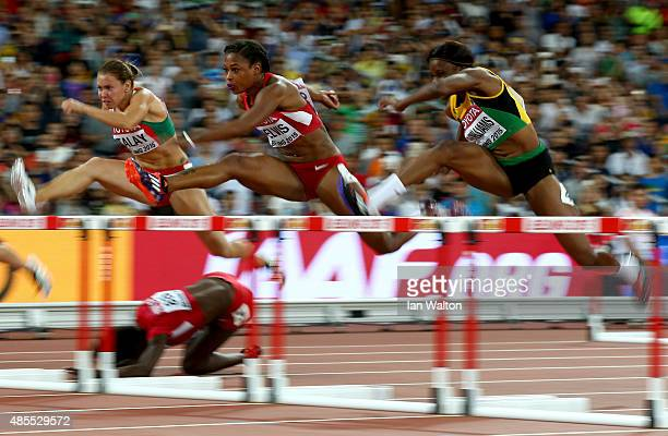 Dawn Harper Nelson of the United States falls as Alina Talay of Belarus Sharika Nelvis of the United States and Danielle Williams of Jamaica continue...